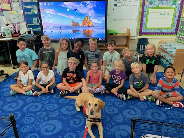 first grade students and Dixie Dog
